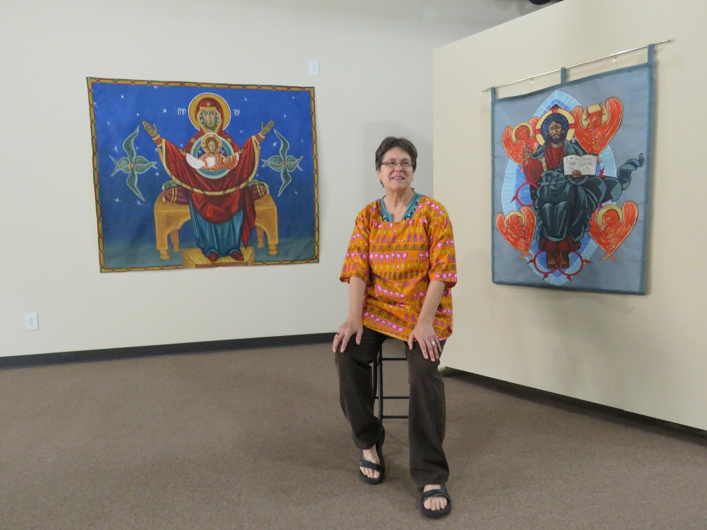 Sr. Glynis McManamon sits with two of her icons at Shepherding Images Studio and Good Shepherd Gallery in Ferguson, MO.